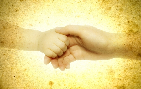 grasping: Newborn grasping parents finger Stock Photo