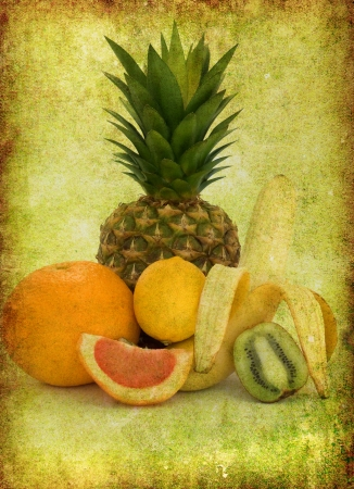 Fresh tropical fruit on a grungy  background Stock Photo - 18188582