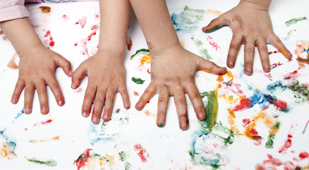 small child: Colorful children hand print on the wallpaper