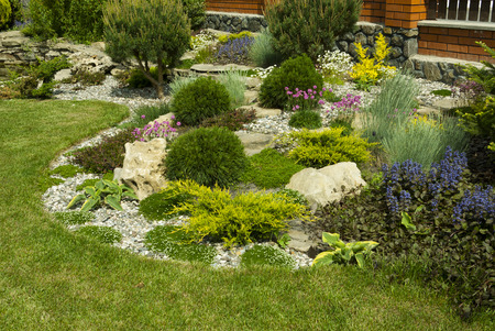landscaped garden: Green lawn in a colorful landscaped formal garden.Detail of a botanical garden Stock Photo