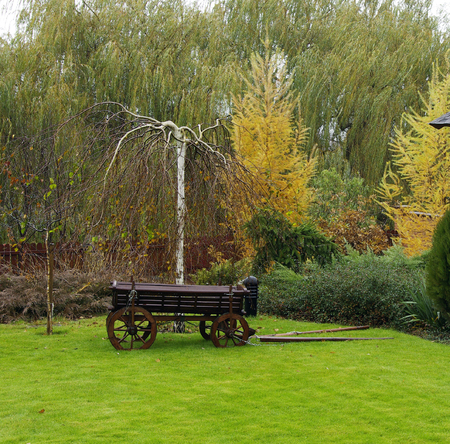 Landscaping in the garden. Peaceful Garden with a Freshly Mown Lawn Stock Photo