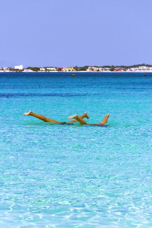 sandy beaches: The most beautiful sandy beaches of Apulia: water games.Porto marine Cesareo, Salento coast. ITALY (Lecce) Stock Photo
