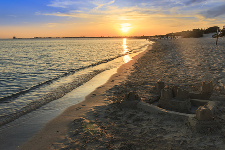 The most beautiful sandy beaches of coast Apulia.Salento: shoreline at sunset. Porto Cesareo beach. ITALY (Lecce) .The sandy coastline is caratterizzata by dunes covered with Mediterranean scrub.It is a tourist resort thanks to its sunny beaches extending