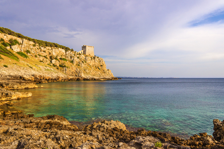 inlet bay: Salento sescape. Bay Porto Selvaggio: in the background DellAlto watchtower.ITALY (Apulia) .The coast is rocky and jagged, and characterized by pine woods and Mediterranean bush.Salento is dotted with watchtowers as always it Has Been the subject of Nume Stock Photo