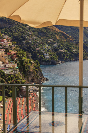 bather: Summertime seascape. Amalfi coast: Positano beach.Italy (Campania) .Panoramic view from the tables of a bar.