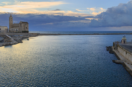 Harbor at sunset: Trani cathedral (Apulia) -ITALY-Its a great example of Apulian Romanesque architecture.It was built using a calcareous tuff, caratterizzato by its color, an extremely light pink.