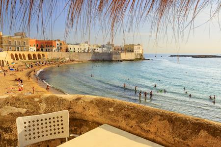 bather: SUMMER SEASCAPE. Salento coast: Gallipoli beach.Apulia (ITALY).