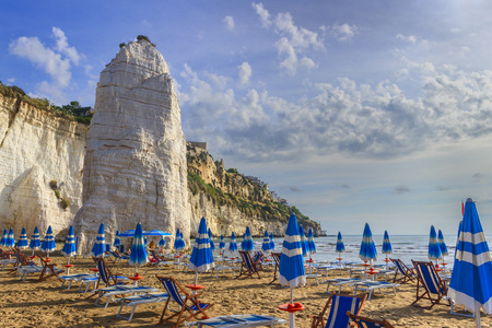 Gargano coast: bay of Vieste (Apulia) ITALY.Castello or Scialara beach: it is overshadowed by the Swabiam Castle and the Pizzomunno Monolith (from the local dialect: peak of cape of the world).