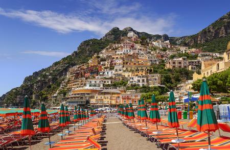 bather: Summertime seascape. Amalfi coast: Positano beach: the skyline of the town. Italy (Campania).
