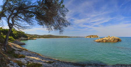inlet bay: Summertime relax.The most beautiful coasts of Italy: Bay of Vieste .- (Apulia, Gargano) -In the foreground or the Portonuovo Portonuovo Islet and in the background the town of Vieste. Stock Photo