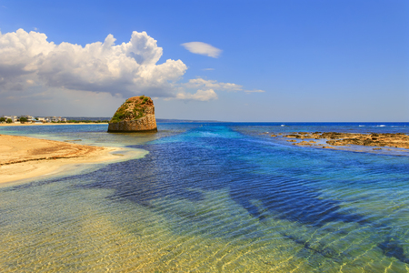 holydays: SUMMER Salento coast: Torre Pali beach (Lecce). ITALY (Apulia) .The low sandy coastline is charactherized by dunes covered with Mediterranean scrub.Its name comes from the sixteenth-century watchtower.