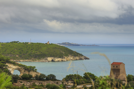 felice: Apulia coast: panoramic view of San Felice Bay, Italy.Gargano National Park: the little rock arch (Architello) is spectacular symbol of Vieste town.