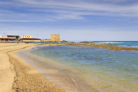 cardinal points: Summer beach holidays.Torre Santa Sabina (Brindisi) ITALY .- (Apulia) .The tower of Santa Sabina has star-shaped with four corners oriented to the cardinal points, with embattled crowning.