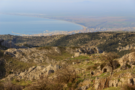 Adriatic coast: the Gulf of Manfredonia.ITALY (Apulia). Gargano promontory: panoramic view from Mount SantAngelo.Rural landscape with trulli and pasture. Stock Photo
