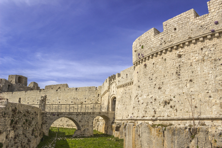 preceded: View of the Monte SantAngelo Castle.It is an architecture in the Apulian city of Monte SantAngelo, Italy (Apulia).The portal is preceded by a bridge with two arches placed across the moat.