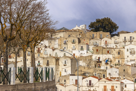 gargano: Italian cityscape. Monte SantAngelo is a town on the slopes of Gargano.View of the district Junno caratterizzata by the presence of many terraced houses surmounted by a large and unique window with gabled roof (Italy). Stock Photo