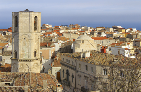 Panorama of Monte SantAngelo: it is a town on the slopes of Gargano.View of octagonal bell tower of Saint Michael Archangel Sanctuary at Monte SantAngelo on Italy (Apulia).