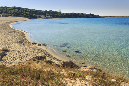 Summer seascape,Apulia coast: Marina di Pulsano beach (Taranto),  Lido Silvana bay. The coastline is characterized by a suggestive alternation of sandy coves and jagged cliffs overlooking a truly clear and crystalline sea. Stock Photo