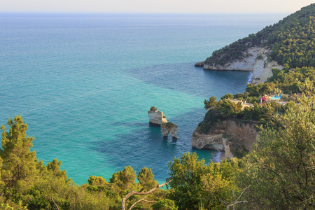 Zagare Bay (or Mergoli Bay) is one of the most beautiful coast of Gargano (Apulia). There are two beaches separated by two stacks located in the sea called Arco di Diomede and Le Forbici.Italy.