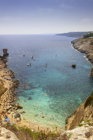 Summer seascape, Apulia coast: Salento beach: Miggiano bay. Its characterized by a alternation of sandy coves and jagged cliffs overlooking a truly clear and crystalline sea. Stock Photo
