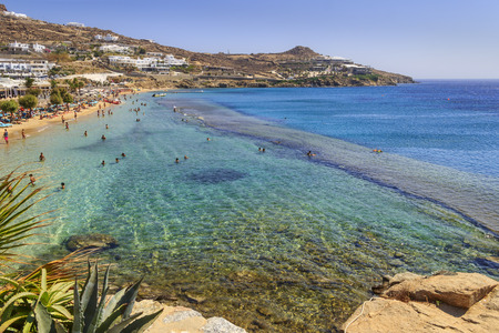 Paradise beach ,Kalamopodi, of Mykonos, Greece. Sunny with blue sky and crystal clear water. Paradise is definitely the most famous  beach of Mykonos: thin sand and emerald green water.