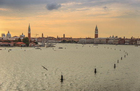 Venice panorama from sea during magical sunset. Romantic sky of Venice: aerial view of Piazza San Marco or st Mark square, Campanile and Palazzo Ducale or Doge Palace. Italy, Europe.
