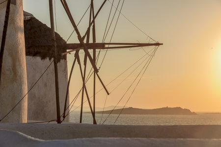 Seascape at sunset with white famous windmills, the symbol of Mykonos Cyclades, Greece. 版權商用圖片