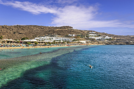 Summertime. Mykonos: Paradise beach (Kalamopodi),Greece. Sunny with blue sky and crystal clear water. Paradise is definitely the most famous beach of Mykonos: thin sand and emerald green water.