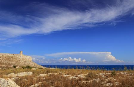 The most beautiful landscape of Italy: Salento, Apulia. In the background SantEmiliano tower located in The Otranto Santa Maria di Leuca Coast and Tricase Woods.