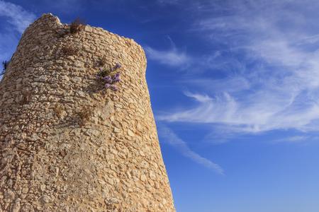 Salento coastline: Minervino watchtower. This medieval ruin is located in The Otranto Santa Maria di Leuca Coast and Tricase Woods Regional Nature Park. Italy (Apulia).