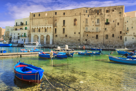 Old port of Monopoli province of Bari, region of Apulia, southern Italy: view of the old town with fishing and rowing boats, Italy. 版權商用圖片