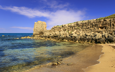 Remains of an ancient Messapian wall in the marine area of Gnatia (Egnazia). Egnatia or Ignatia  was an old city of the Messapians in Apulia, Italy. Along the coast the vestiges of the ancient port. 版權商用圖片