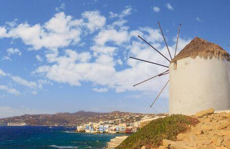 White famous windmills overlooking Little Venice and Mykonos old town, Mykonos, Cyclades, Greece. 版權商用圖片