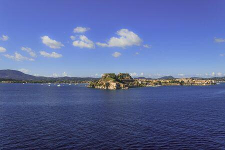 Skyline of Kerkyra (Corfu City) seen from Ionian Sea, Corfu Island, Greece, Europe. Corfu or Kerkyra is a city and a former municipality on the island of Corfu, Ionian Islands, Greece.