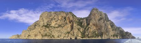 Landscapes of the island of Capri from the sea.View of the coastline with the rocky shores and sea caves.
