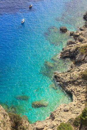 Mediterranean sea with hammock on blue water, Capri island, Italy.