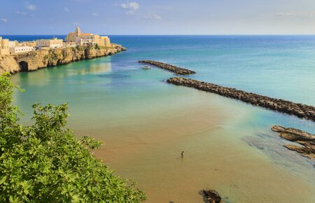 Gargano coast: bay of Vieste, (Apulia) Italy. Panoramic view of the old town. The medieval center perches on a small rocky peninsula: in the background the church of San Francesco.