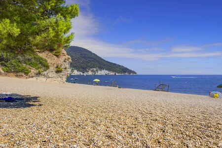 The most beautiful beaches of Apulia: Vignanotica. It is a stretch of pebbles and gravel, surrounded by the cliff dropping sheer to the sea, located in Gargano National Park near Vieste (Italy).