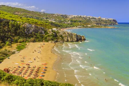 The most beautiful beaches of Apulia: Zaiana Bay, enclosed by two rocks, stretches a few kilometres away from Peschici, in Gargano, Italy.