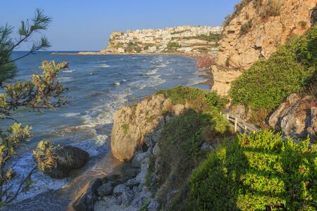 View of the bay of Peschici: the marina and the sandy beach, Italy (Puglia). Peschici is famous for its seaside resorts, its territory belongs to the Gargano National Park.