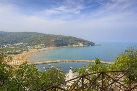 Panoramic view of the bay of Peschici: the marina and the sandy beach, Italy (Puglia). Peschici is famous for its seaside resorts, its territory belongs to the Gargano National Park.
