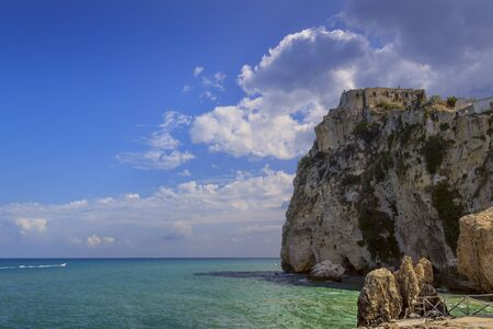 Peschici old town: Norman Castle on the cliff. Resting on a high cliff overlooking the sea, the Castle of Peschici embellishes the already picturesque aspect of this village,Italy (Puglia).