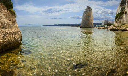 Gargano coast: bay of Vieste,(Apulia) ITALY.Castello or Scialara beach:it is overshadowed by the Swabiam Castle and the Pizzomunno Monolith (from the local dialect: peak of cape of the world).