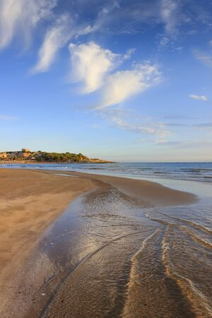 Gargano coast: Bay of Vieste, (Apulia) Italy. Convento or San Lorenzo beach, which is so long that it has two names, is located nearby Vieste and is buzzing with private and public beaches.