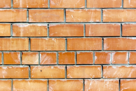 The old weathered stained red brick wall background photo
