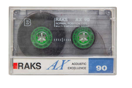 Krasnodar, Russia - March 11, 2021: A worn and scratched RAKS cassette player with an audio cassette inside isolated on a white background