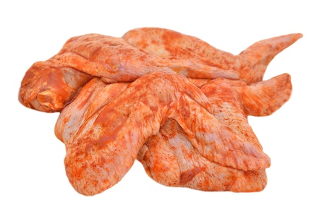 and chicken wings: Marinated chicken wings isolated on white background Stock Photo