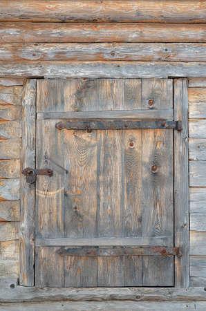 Wooden door of old barn photo