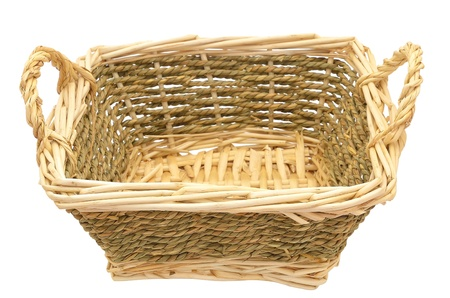 Light wicker basket on a white background  photo