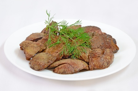 Cooked chicken liver on a white plate
